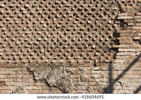 Cracked brick decorative roman time wall background - stock photo