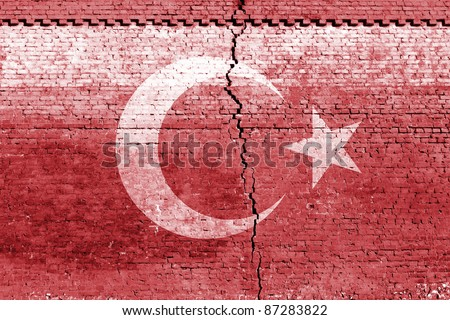cracked brick wall as Turkey flag, symbolize the recent earthquake - stock photo
