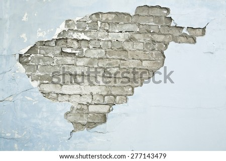 cracked brick wall blue background - stock photo
