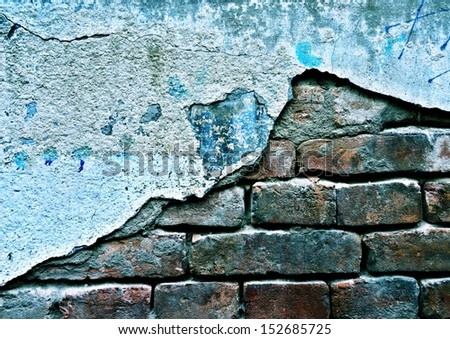 Cracked Brick wall / Old weathered brick wall fragment  - stock photo