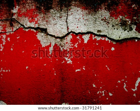 cracked bright red and white wall - stock photo