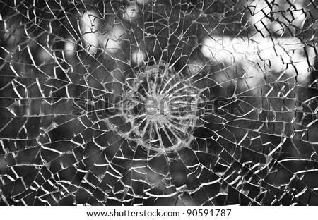 Cracked bullet proof glass - stock photo