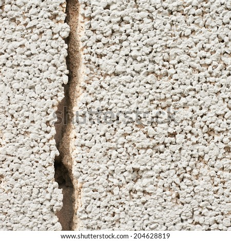 Cracked cement wall fragment as an abstract background composition - stock photo