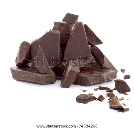 Cracked chocolate pile on white background - stock photo