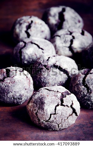 Cracked chocolate shortbread biscuits on old rusty background. Toned. Selective focus - stock photo