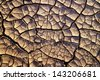 Cracked clay ground into the dry summer season - stock photo