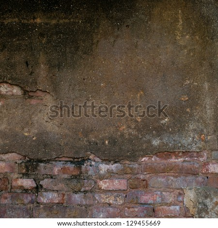 cracked concrete old brick wall background.