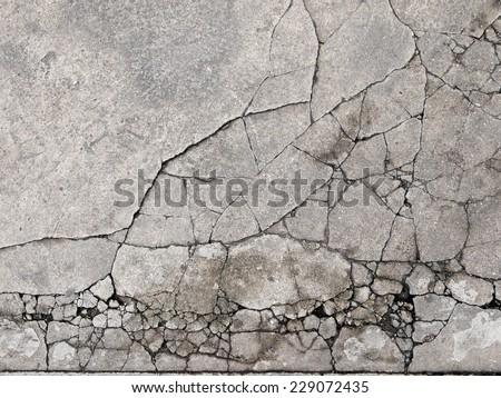 Cracked concrete texture closeup background - stock photo