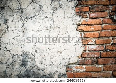 cracked concrete vintage brick wall background - stock photo