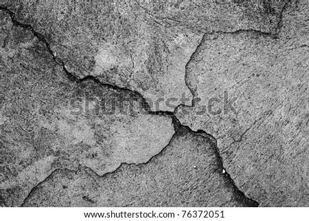 cracked concrete wall - stock photo