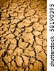 Cracked Dirt Mud Arid Ground Background - stock photo