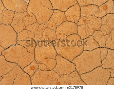 Cracked dry rough clay surface - stock photo