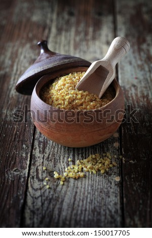 Cracked durum wheat or bulgur made from steamed crushed and dried grains of wheat and a popular ingredient in Middle Eastern cuisine - stock photo