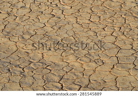 Cracked earth background. Dry and cracked soil into the Wadi Rum desert, Jordan - stock photo