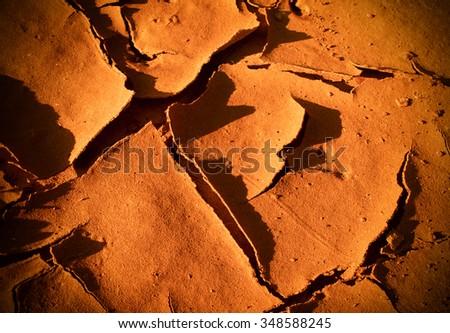 Cracked earth in dry desert - stock photo