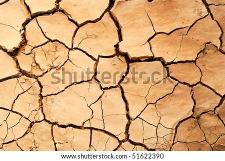 Cracked earth in dry desert. - stock photo