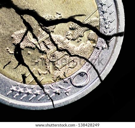 cracked euro coin - stock photo