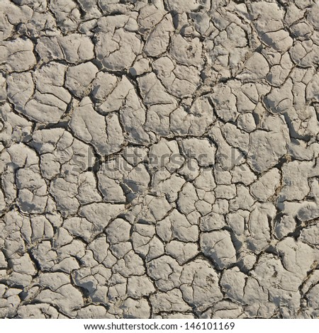Cracked from the heat the earth. Seamless texture - stock photo