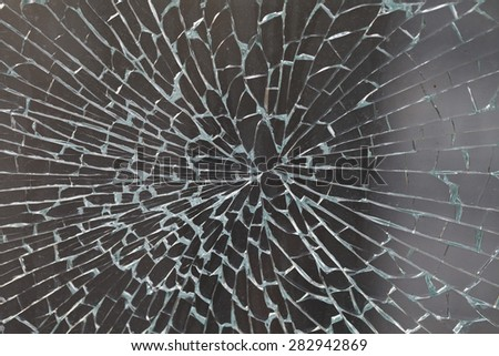 cracked glass closeup background texture - stock photo