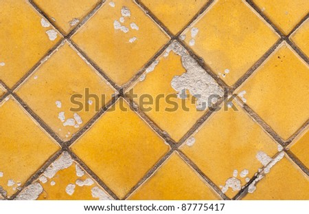 Cracked golden tile - stock photo
