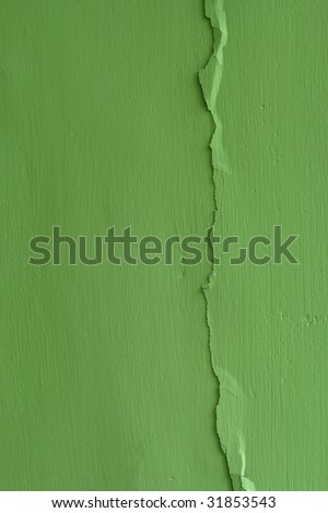 Cracked green wall. Stucco background texture - stock photo
