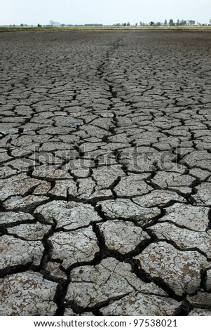 Cracked ground after flood be a long way - stock photo