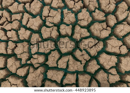 Cracked ground background from Global warming with blue water. - stock photo