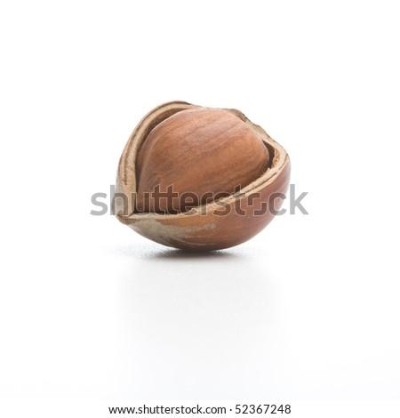 Cracked hazelnut isolated on a white background - stock photo