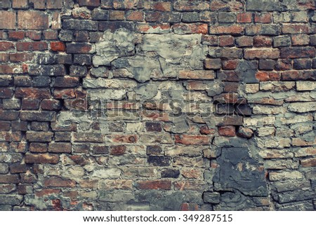 Cracked, heavily damaged brick wall texture background. Vintage effect. Blue shadows.  - stock photo