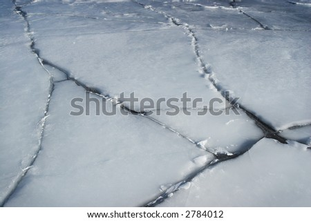 Cracked ice, on a large water body - stock photo