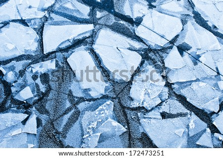 Cracked ice on river - stock photo