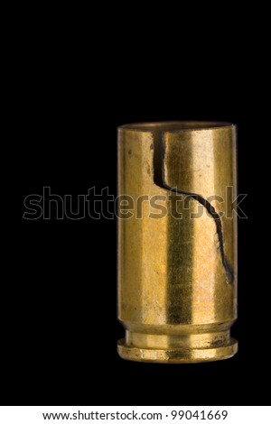 Cracked 9 mm shell casing on black - stock photo
