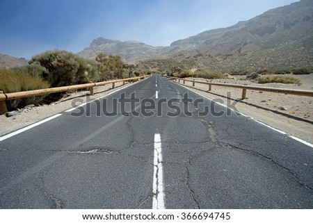 Cracked mountain road on Tenerife, Canary Islands - stock photo