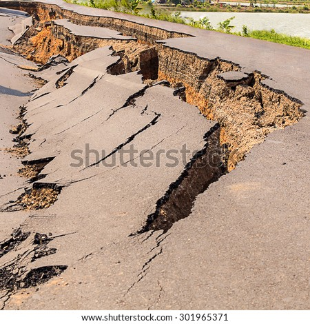 Cracked of asphalt road after the earthquake - stock photo