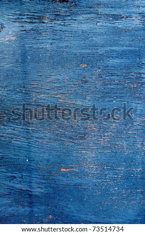 Cracked paint on a wooden surface - stock photo