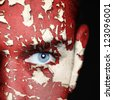 cracked paint on man face - stock photo