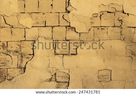 Cracked paint on the outer wall on the old building - stock photo