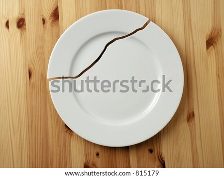 Cracked Plate. - stock photo