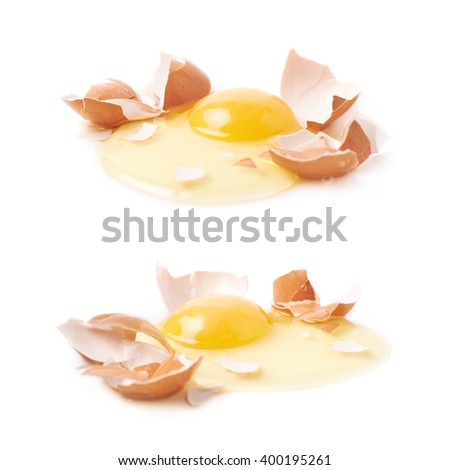 Cracked raw chicken egg isolated - stock photo
