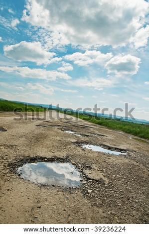 cracked  road - stock photo