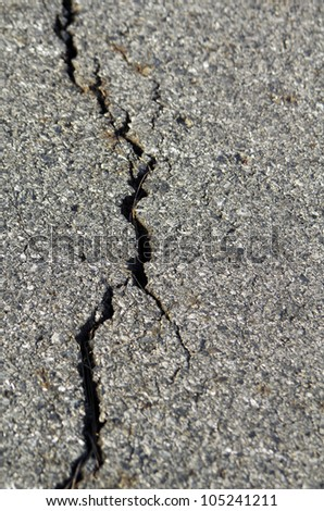 cracked road concrete - stock photo