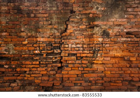 Cracked ruin and dirty orange brick wall vertical - stock photo