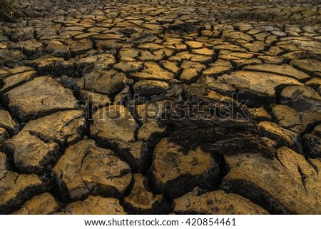 cracked soil from drought, dramatic tone - stock photo