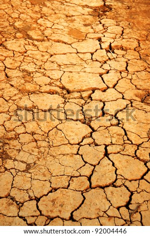 Cracked soil on the way - stock photo