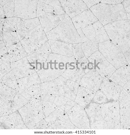 cracked stone wall. - stock photo