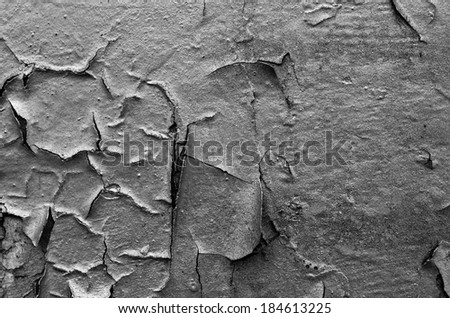 Cracked surface of old black wall