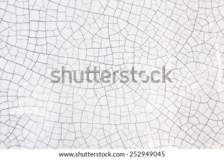 cracked texture of old ceramic pottery - stock photo