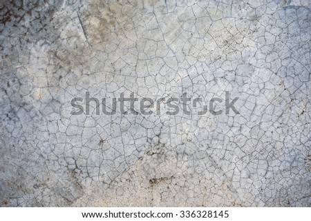 Cracked texture on concrete made by salt.