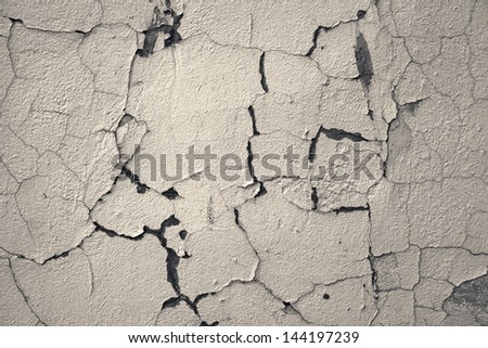 Cracked toned concrete wall - stock photo