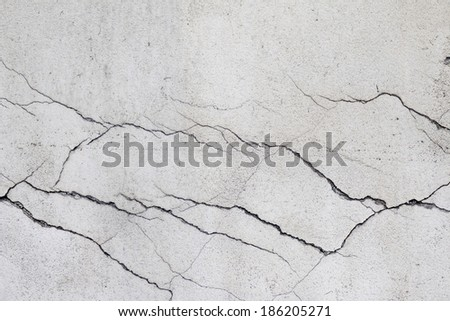 cracked wall - fine cracks on the wall - stock photo